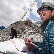 Dave Hahn keeps score during a horseshoe game at Khumbu Basecamp on Mount Everest, Nepal.