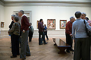 elderly people conversing while on an outing visiting the Metropolitan Museum of Art in New York City