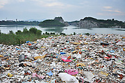 SUZHOU, CHINA - JULY 04: <br /> The lake bank is covered with waste at Taihu National Tourism Vacation Zone on July 4, 2016 in Suzhou, Jiangsu Province of China. Police seized 8 ships which loaded about 4,000 tons of suspected household garbage from Shanghai and arrived at a dock in Suzhou on July 1. Over 20,000 tons of waste was found on the bank within a drug rehabilitation center at the Suzhou Taihu National Tourism Vacation Zone.<br /> ©Exclusivepix Media