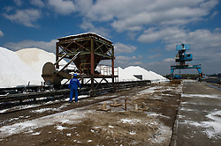 An employee monitors the volume of salt used for producing chlorine, at the Solvay SA chemical plant in Antwerp, Belgium, on Thursday, April 22, 2010.  Solvay SA is the world's largest supplier of Soda Ash or Sodium Carbonate and is also a major producer of caustic soda, hydrogen peroxide, chlorine and fluorinated products. (Photo © Jock Fistick)