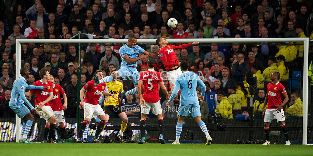 MANCHESTER, ENGLAND - Monday, April 30, 2012: Manchester City's Vincent Kompany scores the first goal against Manchester United during the Premiership match at the City of Manchester Stadium. (Pic by David Rawcliffe/Propaganda)