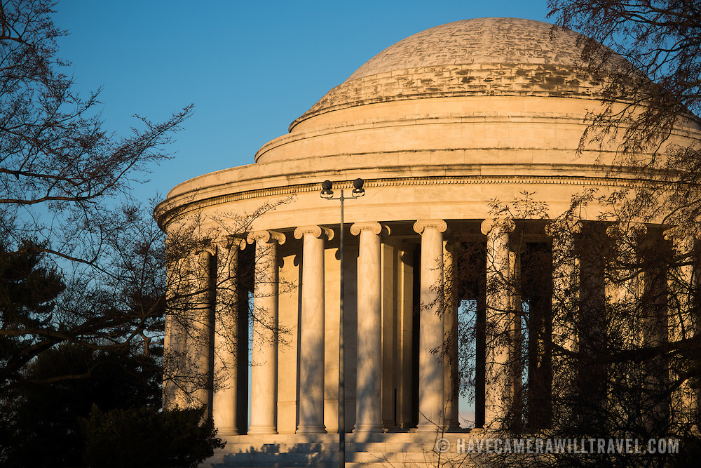 Washington DC. The eastern side of the Jefferson Memorial is bathed in golden light shortly after sunrise.