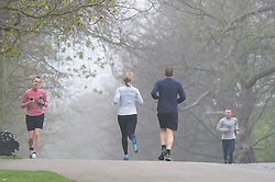 © Licensed to London News Pictures. 07/04/2019.<br /> Greenwich, UK.Sunday morning runners, A foggy damp morning in London and the South East as people are out and about in Greenwich Park, Greenwich, London.  Photo credit: Grant Falvey/LNP