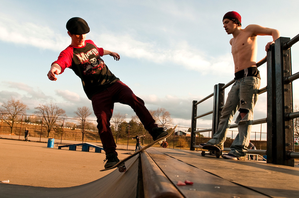 Matt Dixon | The Flint Journal..Chris Rose, 20, of Lapeer (center) skates while Tracy Talcott, 24, of Burton watches at the skate park in Flint, Friday evening.