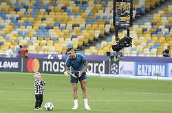 May 25, 2018 - Kiev, Ukraine - Real Madrid's Sergio Ramos is seen on the field as he plays with his kids after the training session for UEFA Champions League Final against Liverpool FC at NSC Olimpiyskyi in Kyiv, Ukraine, May 25, 2018. UEFA Champions League Final  (Credit Image: © Sergii Kharchenko/NurPhoto via ZUMA Press)
