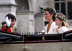 29 April 2011. London, England..Royal wedding day. Pippa Middleton, sister of Catherine leaves the service with a young page boy and bridesmaid..Photo; Charlie Varley.
