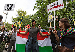 © Licensed to London News Pictures. 16/08/2014. London, UK. Demonstrators protest against attacks by the group Islamic State in Iraq and Syria (ISIS) in central London on 16th August 2014. Campaigners led by the Kurdish People's Assembly gathered outside BBC Broadcasting House before marching through Oxford Street towards the US Embassy. Photo credit : Vickie Flores/LNP