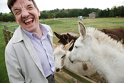 Man with learning disability on trip to farm with donkeys