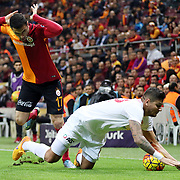 Galatasaray's Burak Yilmaz (L) during their Turkish Super League soccer match Galatasaray between Antalyaspor at the AliSamiYen Spor Kompleksi TT Arena at Seyrantepe in Istanbul Turkey on Saturday, 21 November 2015. Photo by Kurtulus YILMAZ/TURKPIX