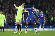 Chris Forrester of Peterborough United and Michy Batshuayi of Chelsea compete for the ball. The Emirates FA cup, 3rd round match, Chelsea v Peterborough Utd at Stamford Bridge in London on Sunday 8th January 2017.<br /> pic by John Patrick Fletcher, Andrew Orchard sports photography.