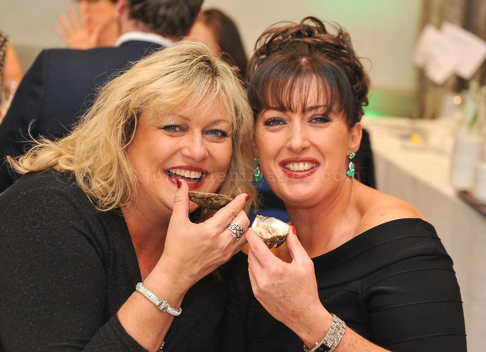 REPRO FREE<br /> Pictured at the 4-course Fruits de Mer Luncheon during the 39th Kinsale Gourmet Festival are singers Sharon Crosbie and Grainne Ryan enjoying Oysters.<br /> Picture. John Allen<br /> <br /> KINSALE GOURMET FESTIVAL PRESENTS:<br /> A WEEKEND OF FINE FOOD AND WINE IN A FUN ATMOSPHERE<br /> The 39th Kinsale Gourmet Festival takes place from 9-11 October 2015, promising a weekend of fine food and wine in a fun atmosphere.  The Festival is hosted by Kinsale's eleven Good Food Circle restaurants, which go to great lengths to display the talent of their chefs, and their beautifully presented food. The emphasis is on locally-sourced ingredients from sea and land, accompanied by carefully selected wines. The United States Ambassador to Ireland, Kevin O'Malley, will be a guest in Kinsale for Friday and Saturday's Good Food Circle events. Kinsale Gourmet Festival has many regular visitors from overseas, including the United States and Canada. There are still some tickets left for Friday evening's opening event, a champagne reception, courtesy of Laurent Perrier, and a 5-course 'Taste of West Cork' dinner in a Good Food Circle restaurant of your choice.  Meanwhile, everyone is welcome to the 'Cork Heat' of the All-Ireland Chowder Cook-Off on Friday afternoon, sponsored by Clóna.<br /> Acton's Hotel is the venue for the Cork Heat of the All-Ireland Chowder-Cook off  at 3pm on Friday 9 October.  The €5 admission fee includes the chance to win a €100 gift voucher from the Kinsale Good Food Circle, as well as a tasting sample of each chef's chowder, and free samples from specialised local brewers of craft beers and cider makers.  Some outstanding chefs are expected to compete, including the very popular winner of last year's Cork Heat, The Cornstore.  An entertaining afternoon is guaranteed, as the chefs display their skills with seafood, sharing their secret ingredients, as they compete to produce the tastiest chowder.  The winning chef will represent Cork at the 