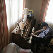 World War II veteran Thomas L. Maloney, 99, shares his musical talents on the piano at his home in Toledo on Thursday, May 20, 2021. Maloney turns 100 next week. THE BLADE/KURT STEISS<br /> <br /> DESK NOTE: Please at least include this photo in the online story. This is my favorite photo from this assignment.