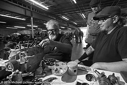 """The master at work - Carl Olsen working on one of the Cannonball bikes he built on the  Friday """"Rest Day"""" between stages 7 and 8 of the Motorcycle Cannonball Cross-Country Endurance Run in Junction City, KS., USA. Friday, September 12, 2014.  Photography ©2014 Michael Lichter."""