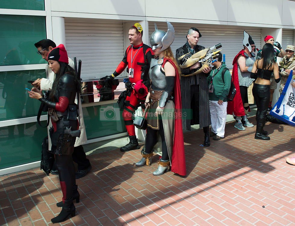 July 20, 2017 - San Diego, California, U.S. - Attendees wait outside the San Diego Convention Center where unusually long lines greeted fans on the first day of Comic-Con International.  (Credit Image: © Kevin Sullivan/The Orange County Register via ZUMA Wire)