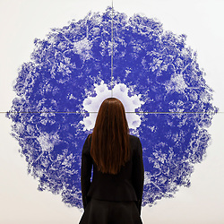 "© Licensed to London News Pictures. 25/09/2019. LONDON, UK. Artist Roberto Lombana poses with her work ""Dos Selva / The Amazon Mandala"", 2019, at the preview of START, a contemporary art fair comprising eclectic works from a variety of international emerging artists.  The fair takes place at the Saatchi Gallery in Chelsea 26 to 29 September 2019.  Photo credit: Stephen Chung/LNP"