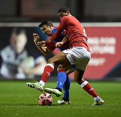 Doncaster's Enda Stevens tussles with Bristol City's Mark Little during the FA Cup third round replay between Bristol City and Doncaster Rovers at Ashton Gate on January 13, 2015 in Bristol, England.- Photo mandatory by-line: Paul Knight/JMP - Mobile: 07966 386802 - 13/01/2015 - SPORT - Football - Bristol - Ashton Gate Stadium - Bristol City v Doncaster Rovers - FA Cup third round replay