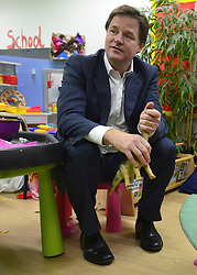 © Licensed to London News Pictures. 13/11/2012. London, UK Nick Clegg sits on a child's chair and plays with a toy dinosaur whilst visiting the Nursery. Deputy Prime Minister Nick Clegg visits the 'Third Door', in Putney today Putney today, 13 November 2012. An innovative centre combining a workspace for parents and childcare for their children, parents can drop off their children in the nursery, and hire a working space including desk, meeting room and facilities. He announced new flexible parental leave for parents, mothers and fathers can now share the maternity leave allowance.. Photo credit : Stephen Simpson/LNP