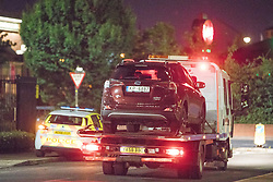 © Licensed to London News Pictures. 10/08/2017. Salford, UK. A maroon coloured Toyota car is driven away on a low loader from the scene in a car park at the rear of the Ibis Hotel in Salford Quays where a young boy was killed in a collision with a car earlier this evening (Thursday 10th August 2017) . Photo credit: Joel Goodman/LNP