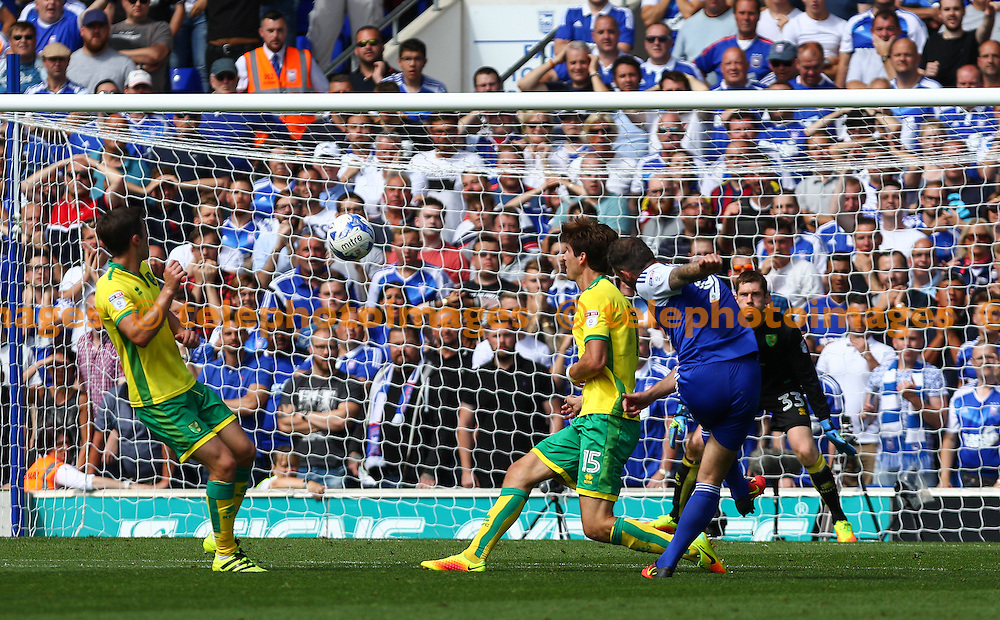 Daryl Murphy of Ipswich Town (blue) shoots during the Sky Bet Championship match between Ipswich Town and Norwich City at Portman Road in Ipswich. August 21, 2016.<br /> Arron Gent / Telephoto Images<br /> +44 7967 642437