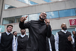 May 23, 2019 - Dayton, Ohio, United States - Members of the Church Of God sing gospel songs as a way of protest against Ku Klux Klan members rallying in city square in down town Dayton, Ohio. The six Klan members were surrounded by more than 600 counter protesters in city square. (Credit Image: © Megan Jelinger/SOPA Images via ZUMA Wire)