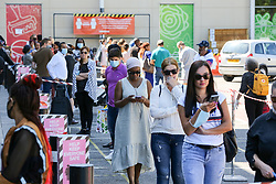 © Licensed to London News Pictures. 15/06/2020. London, UK. Shoppers queue outside TK Maxx store in Haringey, north London as non-essential stores reopen after three months of COVID-19 lockdown Photo credit: Dinendra Haria/LNP