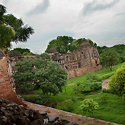 North-South arm of the Madrasa and Mosqueq overlooking the reservoir at Hauz Khas village. Hauz Khas in South Delhi houses a water tank, an Islamic seminary, a mosque, a tomb and pavilions built around an urbanized village with medieval history traced to the thirteenth century of Delhi Sultanate reign. The Hauz Khas village which was known for the amazing buildings built around the reservoir drew a large congregation of Islamic scholors and students to the Madrasa for Islamic education.