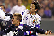 10 February 2006: Japan's Tsuneyasu Miyamoto (5) battles US forward Taylor Twellman (20) for position at the top of the penalty area. The United States Men's National Team defeated Japan 3-2 at SBC Park in San Francisco, California in an International Friendly soccer match.