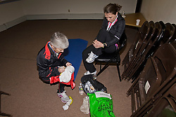 """Joan Samuelson prepares for race in elite athlete holding area with daughter, Abby, writing """"will power"""" on cap"""