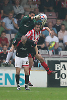 Photo: Pete Lorence.<br />Lincoln City v Milton Keynes Dons. Coca Cola League 2. 16/09/2006.<br />Adolfo Vaines of Milton Keynes Dons reaches over another last minute Lincoln City attack.