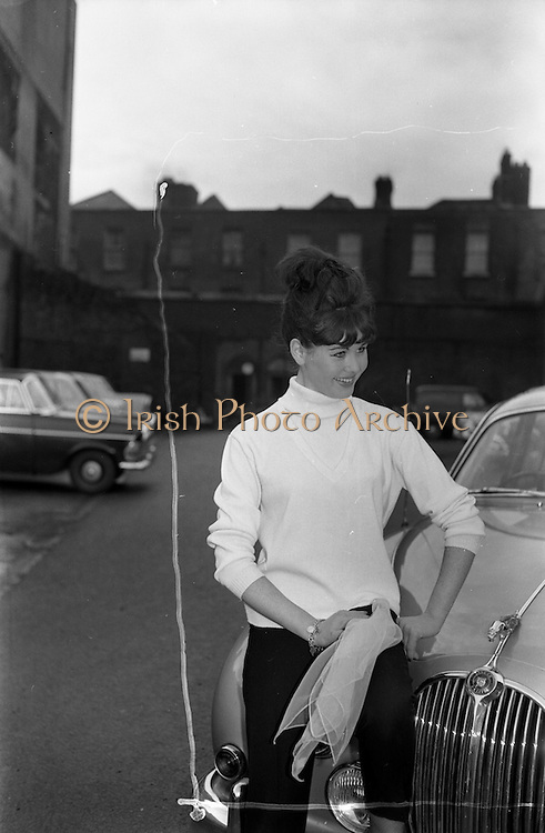 08/02/1963<br /> 02/08/1963<br /> 08 February 1963<br /> Fashions from Todco, Henry Street, Dublin. Model with Jaguar car.