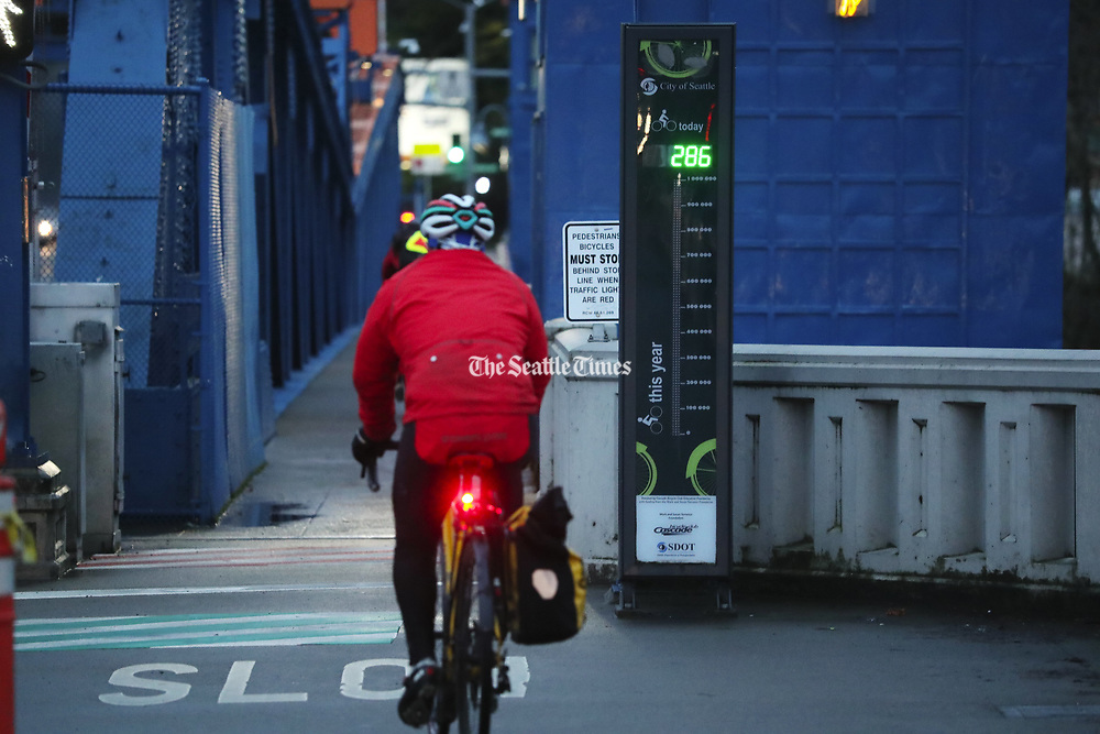 Bike data from 2019 shows that traffic is up 12% at the Fremont Bridge, seen during the morning commute Thursday, Jan. 2, 2020 in Seattle. The bike counter can be seen to the right of path. 212543