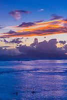 Sunset over the island of Moorea, seen from Manava Suite Beach Resort, Punaauia, Tahiti, French Polynesia.