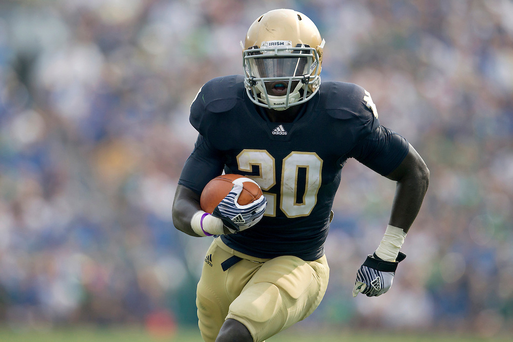 Notre Dame running back Cierre Wood (#20) runs for yardage in action during NCAA football game between Notre Dame and South Florida.  The South Florida Bulls lead the Notre Dame Fighting Irish 16-0 at halftime in game at Notre Dame Stadium in South Bend, Indiana.  The game has been delayed due to rain storms and lightning in the area.