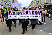 Women with a WASPI Women Against State Pension Inequality at the Bread and Roses Womens March on January 19, 2019 in London, England.  The event was dubbed the Bread and Roses March based on the strikes of the same name by textile workers in Massachusetts in 1912 and Bread and Roses is the title of a poem by American poet James Oppenheim about the strikes.