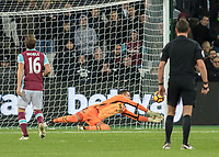 Football - 2016 / 2017 Premier League - West Ham United vs. Stoke City<br /> <br /> Adrian of West Ham dives low to his left  to deny a Charlie Adam free kick at The London Stadium.<br /> <br /> COLORSPORT/DANIEL BEARHAM