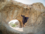 Datoga herder showing me ancient petroglyphs made by the ancestors of the Hadza.