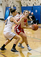 Prospect Mountain's Nadia Huggard keeps pressure on Laconia's during first round play of the 44th annual Holiday Basketball Tournament played at Gilford Middle/High School Wednesday afternoon.  (Karen Bobotas/for the Laconia Daily Sun)