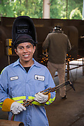 Bernardo Carillo poses for a photograph at a San Jacinto College welding lab, July 7, 2014.