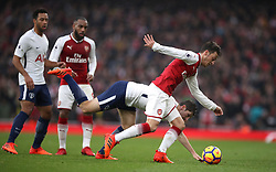 Arsenal's Mesut Ozil (right) battles for possession of the ball with Tottenham Hotspur's Ben Davies