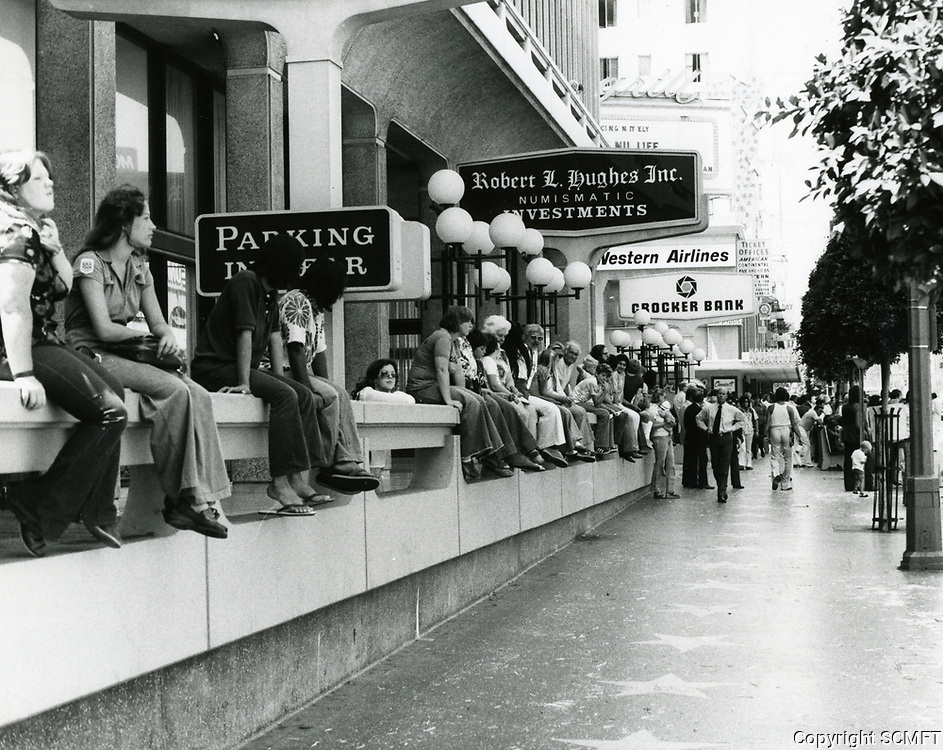 """1976 Spectators watch an auto race on Hollywood Blvd. to advertise the movie """"Gumball Rally"""""""