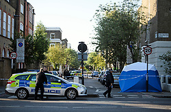 © Licensed to London News Pictures. 12/05/2019. London, UK. Police at the scene near Waitrose in Islington, North London, where a body was found in a wheelie bin on Saturday afternoon. The discovery was made just a few hundred meters from the home of Labour Party leader Jeremy Corbyn. Detectives are now trying to identify the man. Photo credit: Ben Cawthra/LNP