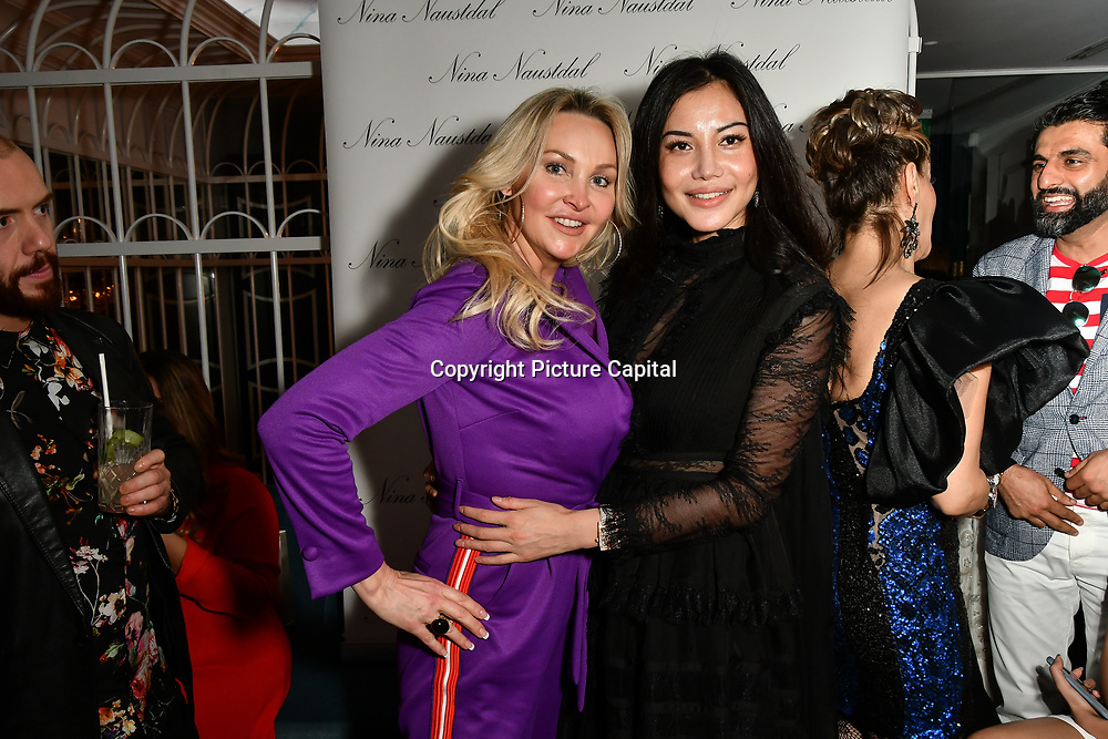 Heather Bird Tchenguiz and Elaine Zhang attend Nina Naustdal catwalk show SS19/20 collection by The London School of Beauty & Make-up at Bagatelle on 26 Feb 2019, London, UK.