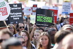 © Licensed to London News Pictures. 12/09/2015. London, UK. Protesters attending a pro-refugee march in central London on September 12, 2015. Pro-refugee demonstrators demand the UK government to help more refugees fleeing Syria. Photo credit: Tolga Akmen/LNP