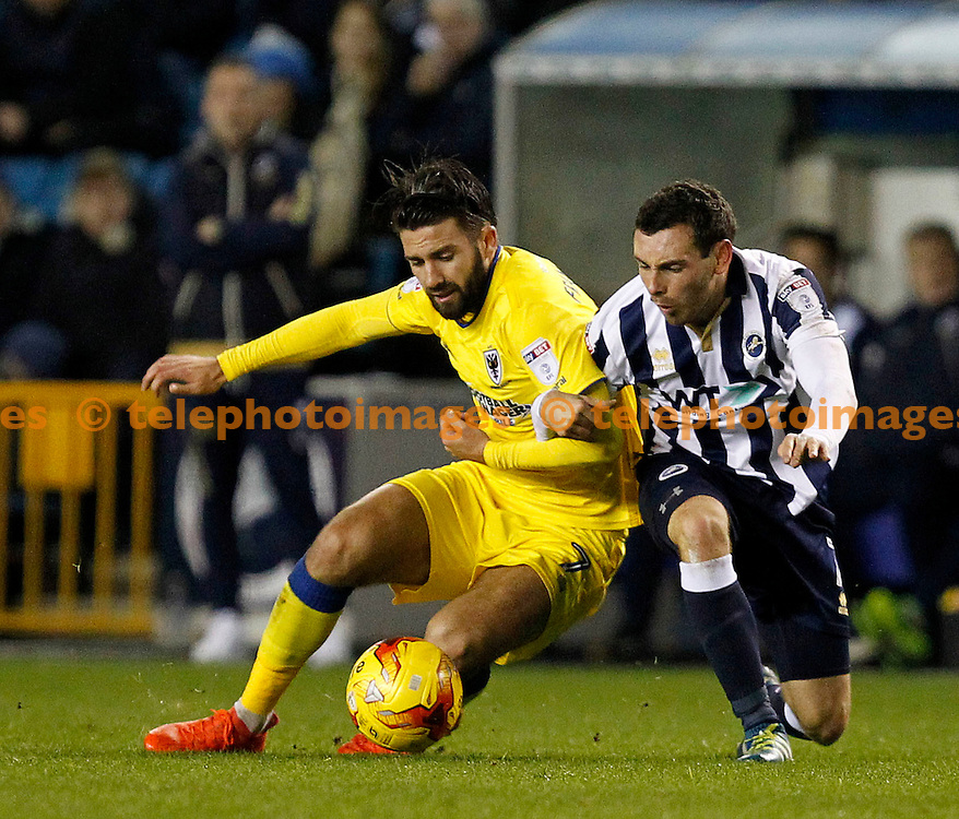 AFC Wimbledon's George Francomb and Millwall's David Worrall go to ground during the Sky Bet League 1 match between Millwall and AFC Wimbledon at The Den in London. November 22, 2016.<br /> Carlton Myrie / Telephoto Images<br /> +44 7967 642437