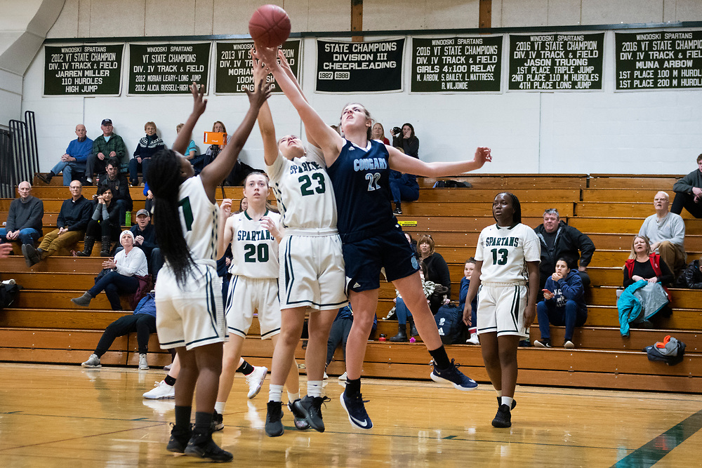 MMU's Allison Fullem (22) and Winooski's Charlotte Pusztai-Renold (23) battle for the rebound during the girls basketball game between the Mount Mansfield Cougars and the Winooski Spartans at Winooski High School on Friday night February 14, 2020 in Winooski, Vermont.(BRIAN JENKINS/for the FREE PRESS)