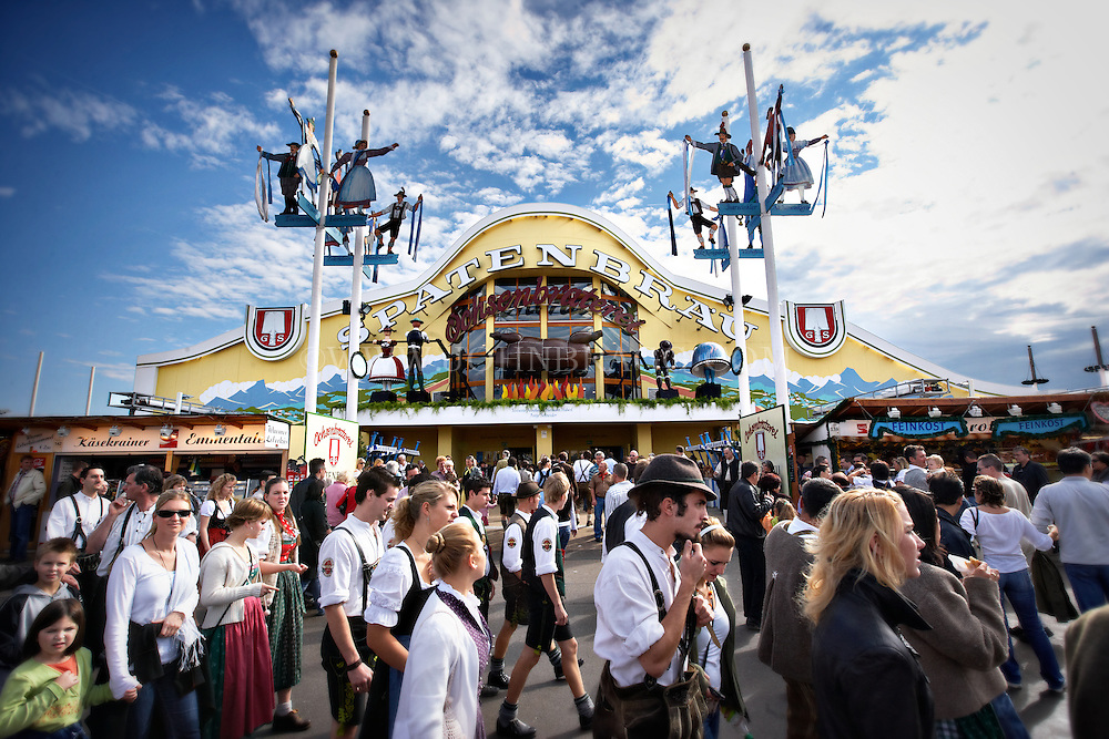 Hundreds of people are walking around in Munich, Germany outside the Spaten tent for Oktoberfest.