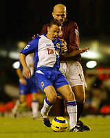 Photo: Chris Ratcliffe.<br />Arsenal v Blackburn Rovers. The Barclays Premiership.<br />26/11/2005.<br />Paul Dickov (L) of Blackburn Rovers and Phillipe Senderos of Arsenal tussle for the ball