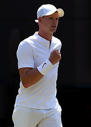 Kyle Edmund celebrates winning the second set against Alex Bolt on day two of the Wimbledon Championships at the All England Lawn Tennis and Croquet Club, Wimbledon.