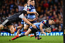 27th April 2019 , Principality Stadium , Cardiff, Wales ; Guinness pro 14's, Round 21, Cardiff Blues Vs Ospreys ; Tomos Williams of Cardiff Blues is tackled by James King of Ospreys<br /> <br /> Credit :  Craig Thomas/Replay Images