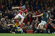 Jonathan Davies of Wales jumps over Rohan Janse van Rensburg of South Africa as he goes on the attack. Under Armour 2016 series international rugby, Wales v South Africa at the Principality Stadium in Cardiff , South Wales on Saturday 26th November 2016. pic by Andrew Orchard, Andrew Orchard sports photography